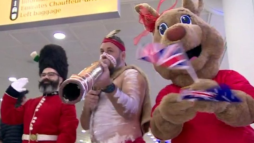 A Queen's Guardsman, didgeridoo player and person dressed as a kangaroo