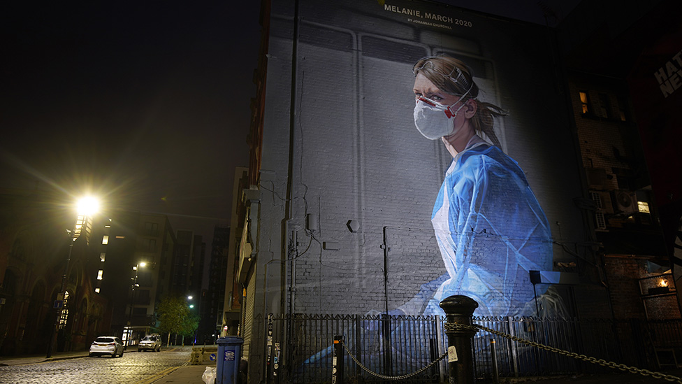 Mural in Manchester of a nurse wearing PPE