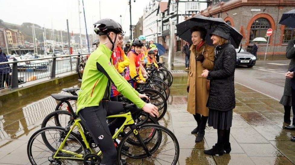 Princess Anne speaking to young cyclists