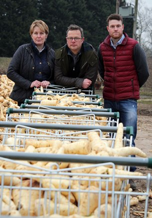 Hugh Fearnley-Whittingstall with the Hammonds and trolleys full of parsnips