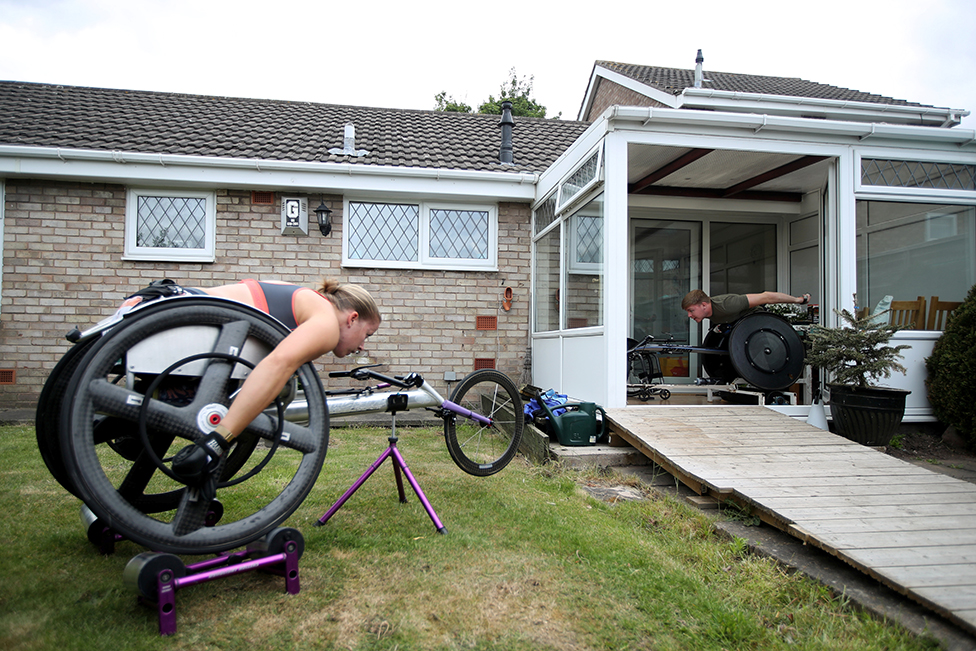 Paralympian hannah cockroft and her partner nathan maguire training in their garden