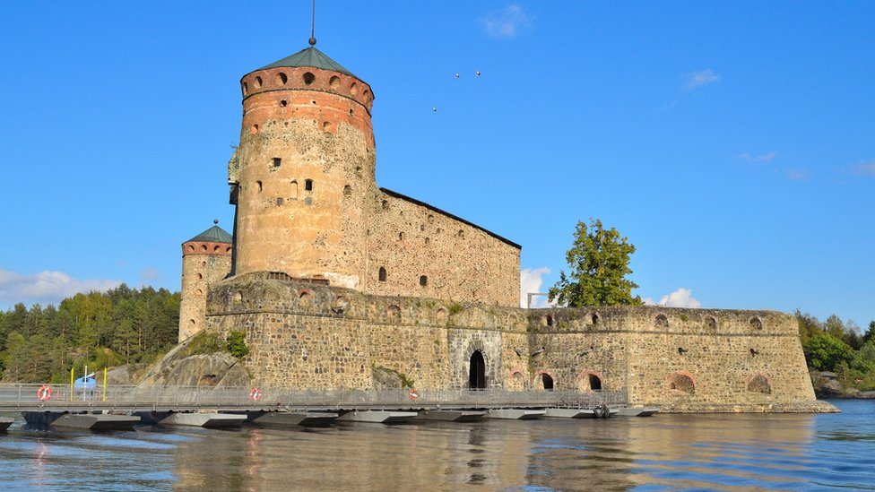 Olavinlinna Castle, which sits on a lake