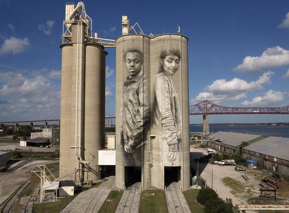 Guido van Helten's mural on the side of two giant grain silos in Jacksonville, Florida.