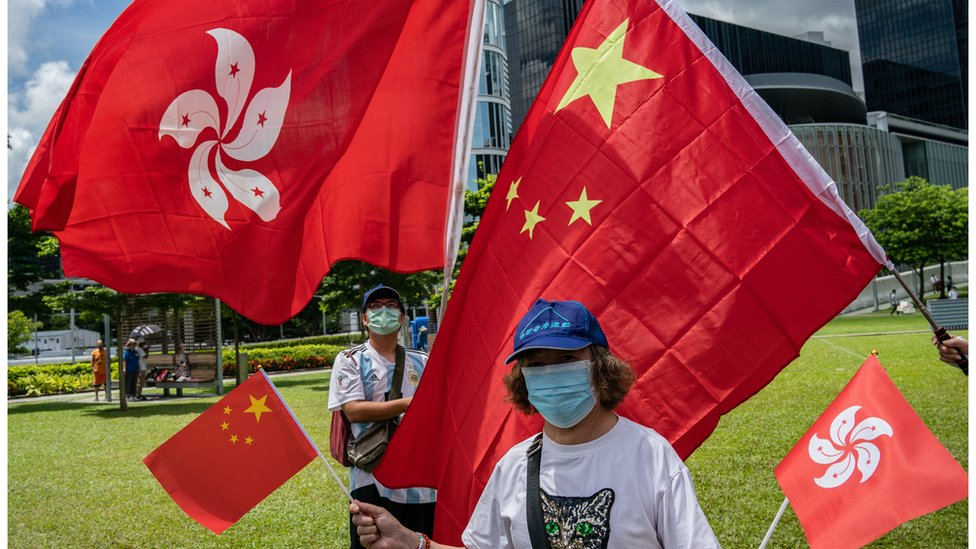 支持《國安法》的人認為,法例可以止暴制亂,讓香港重回正軌。