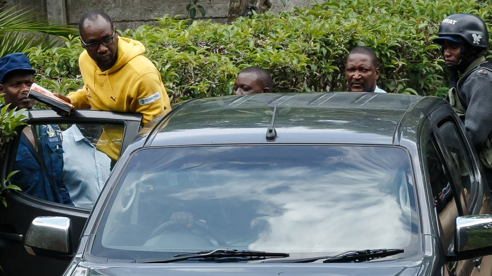 Pastor Mawarire is led into a police vehicle