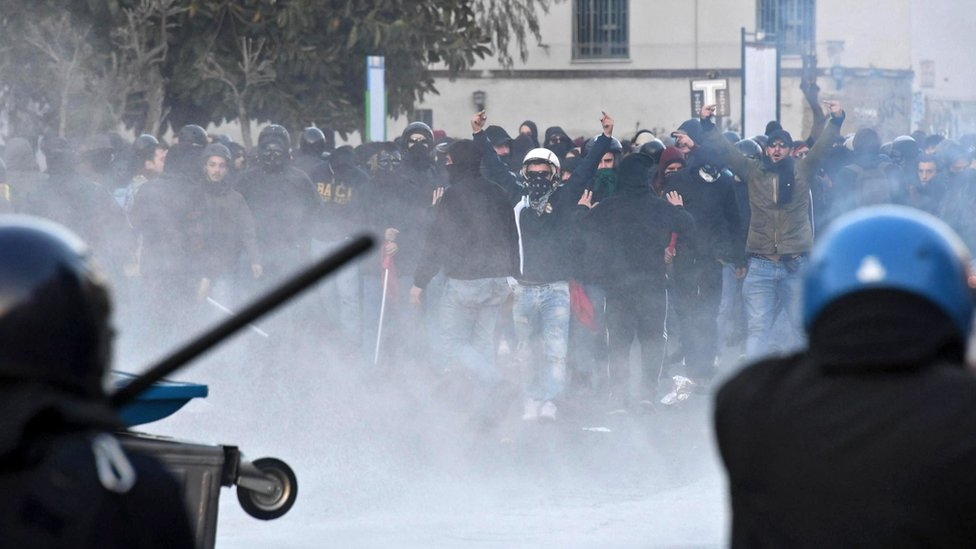 Protesters clash with riot police during a demonstration against the visit of the leader of Italian Lega Nord (North League) party, Matteo Salvini, in Naples, Italy, 11 March 2017