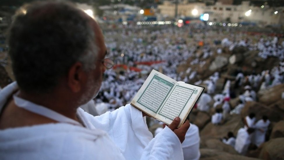 A Muslim pilgrim reads a copy of the Koran, as he joins one of the Hajj rituals on Mount Arafat (11 September 2016)
