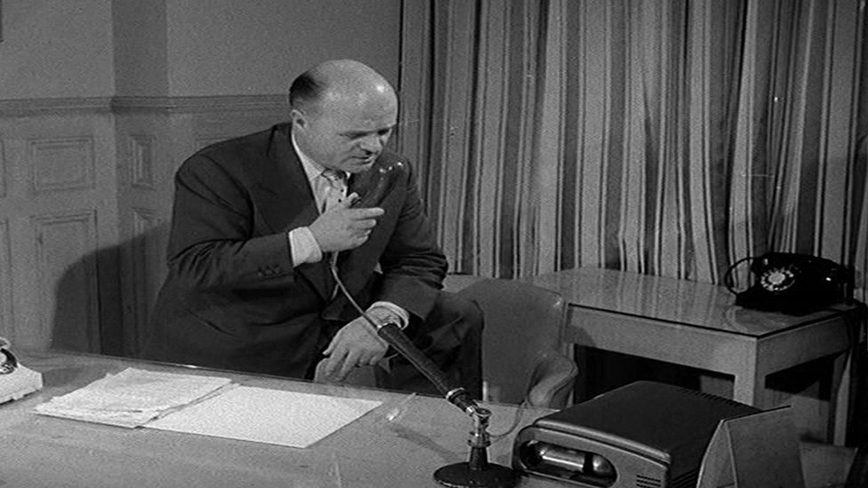 Cyril Lord using a telephone in his office