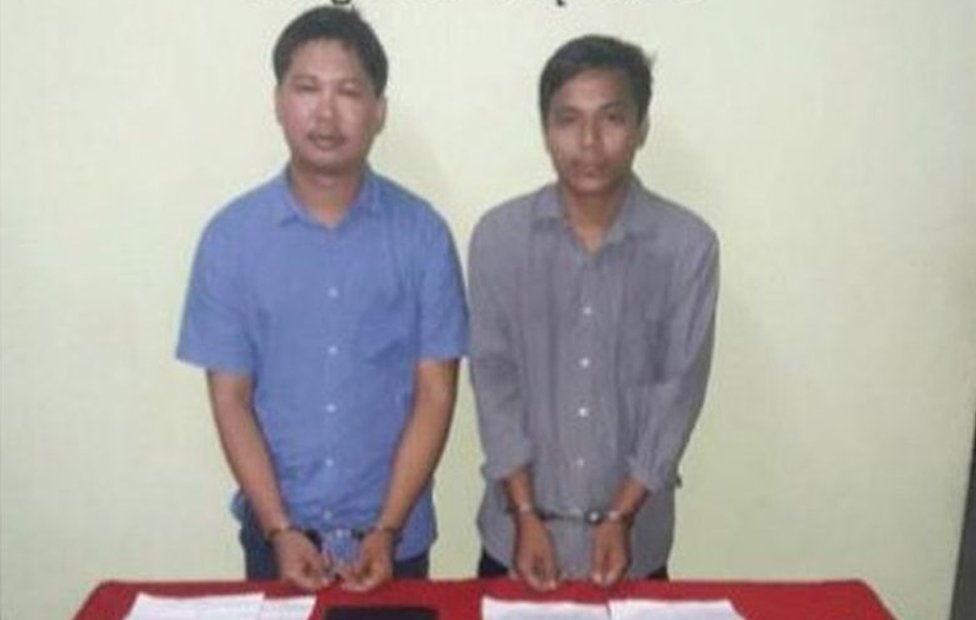Reuters journalists, Wa Lone (L) and Kyaw Soe Oo, are seen in a photo, released on 13 December 2017 by Myanmar Ministry of Information, after they were arrested.
