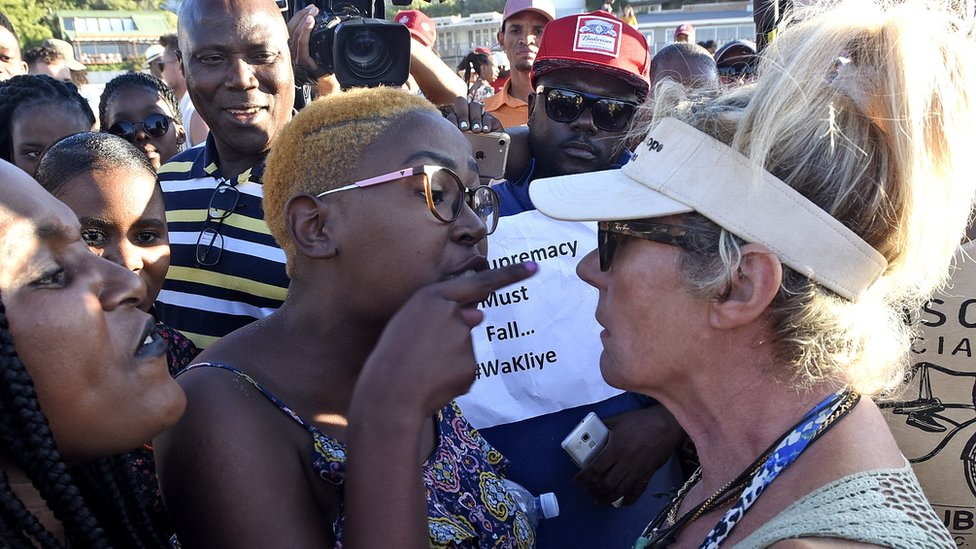 Protestors argue with an animal rights activist (R) before slaughtering a sheep during a protest on Clifton 4th beach in Cape Town, South Africa, 28 December 2018