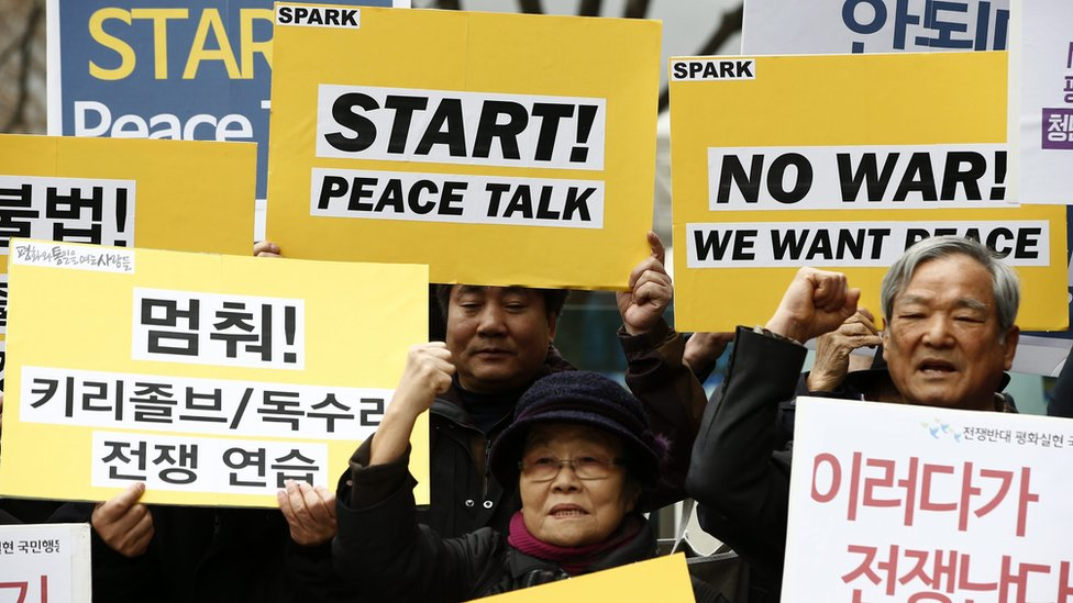 """South Korean protesters shout slogans such as """"Stop War Exercises and Start Peace Talks"""" during a rally against the exercises, in Seoul"""