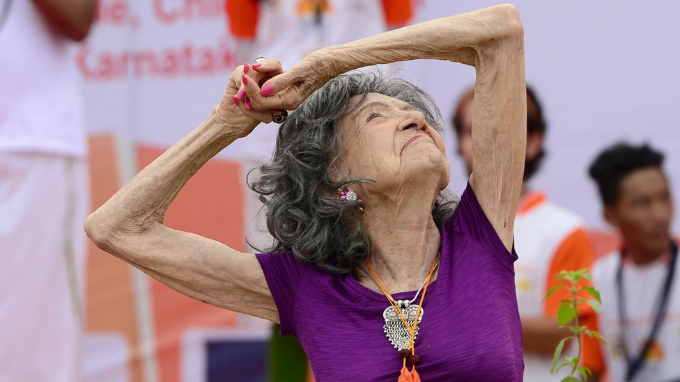 Yoga master Tao Porchon-Lynch, 98, takes part in a mass yoga session on International Yoga Day at the Shree Kanteerava Stadium in Bangalore on June 21, 2017
