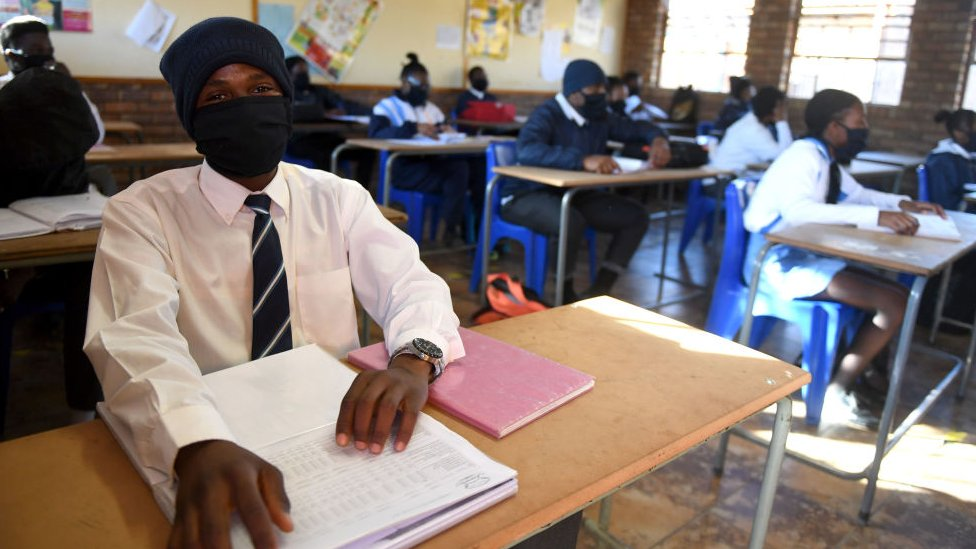 Students wearing face masks in class in South Africa