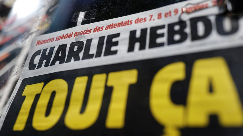 Cropped image of headline on Charlie Hebdo issue released at the start of September