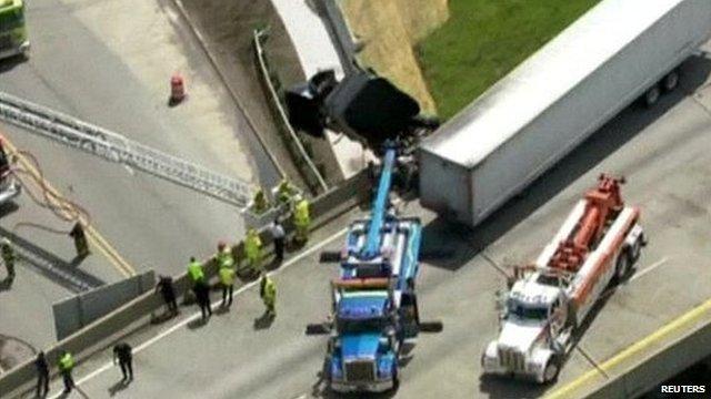 Aerial view of truck dangling from bridge in Michigan