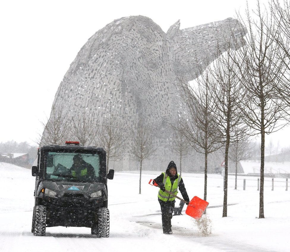 People grit the paths near the Kelpies in Helix Park, Falkirk