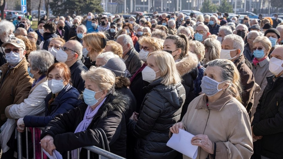 People wait to receive the Pfizer-BioNTech COVID-19 vaccine as the country begins mass vaccination for the coronavirus disease (COVID-19), in Belgrade, Serbia, February 3, 2021