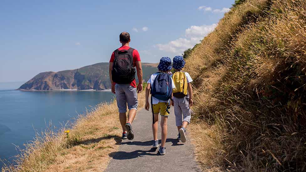 Dad and two boys on coastal walk