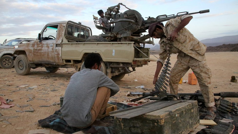 Yemeni tribesmen from the Popular Resistance Committees, supporting forces loyal to Yemen's Saudi-backed President Abdrabbuh Mansour Hadi, prepare and review ammunition in the area of Sirwa, west of the city of Marib.