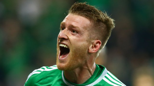 Skipper Steven Davis celebrates one of his two goals in the 3-1 win over Greece which secured Northern Ireland's Euro 2016 qualification