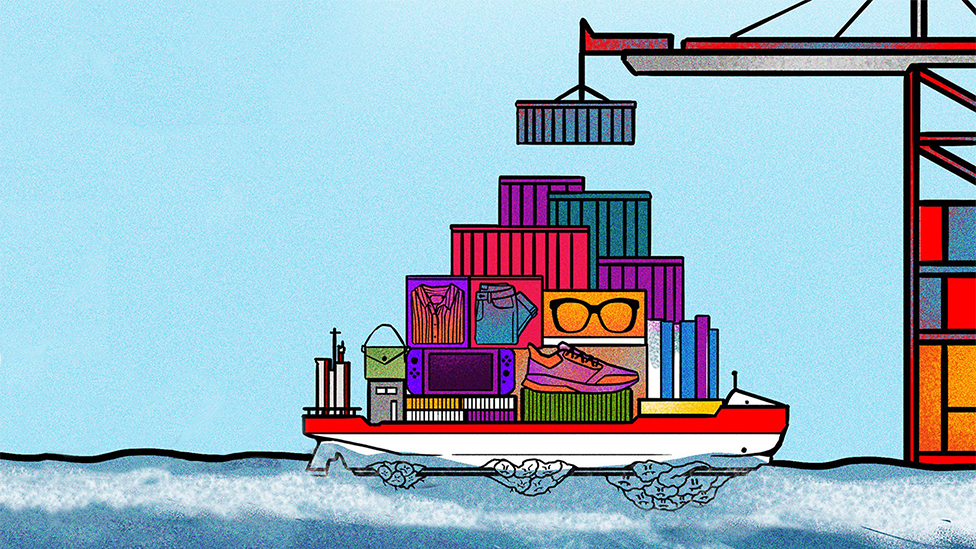 A ship full of cargo containers at sea with mountains of barnacles stuck to its bottom side