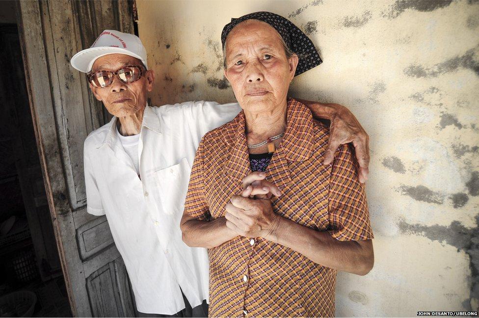 Tran Van Van, 84, and his wife Pham Thi Sang, 77, at their home in Binh Giang