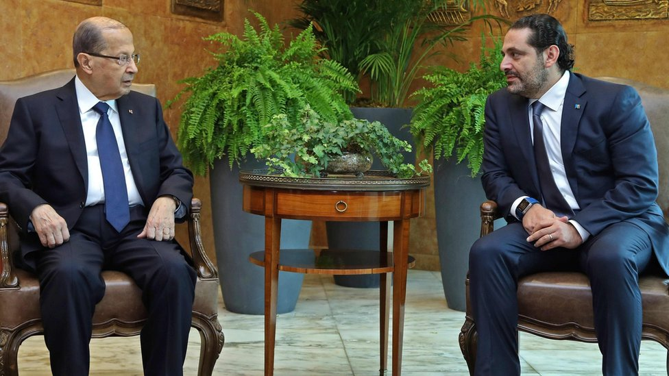 A handout picture shows Lebanese President Michel Aoun (L) and Prime Minister Saad Hariri (R) meeting at the presidential palace in Baabda, outside Beirut (22 November 2017)