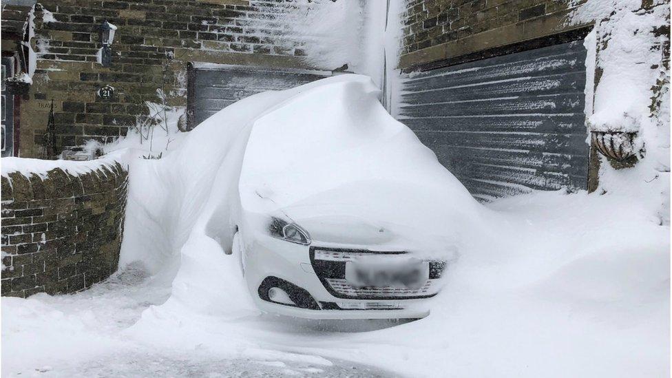 A snowed-in car