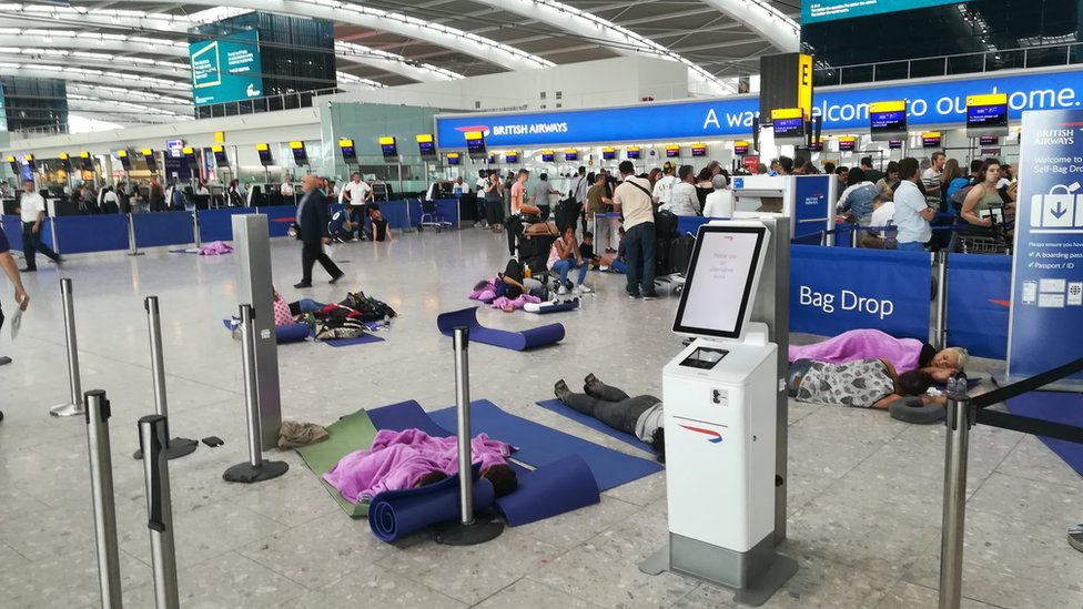 People resting at Heathrow Airport