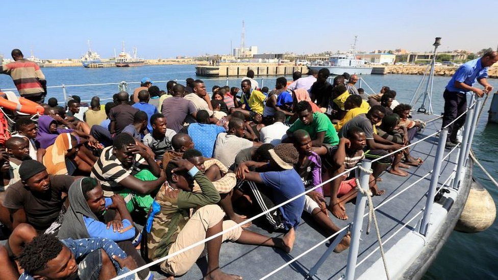 Migrants picked up by the Libyan coastguard on the approach to Tripoli port
