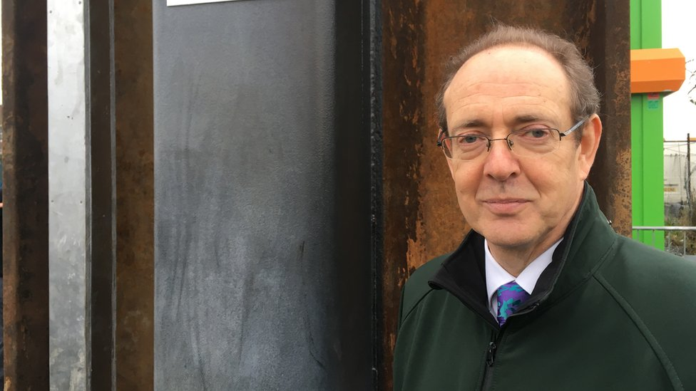 Sir James Bevan pictured at a flood defence in 2016
