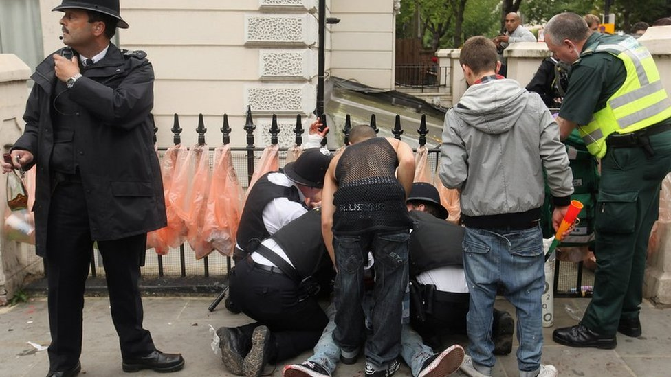 A man is given emergency medical treatment after being stabbed in the stomach at the Notting Hill Carnival in 2011