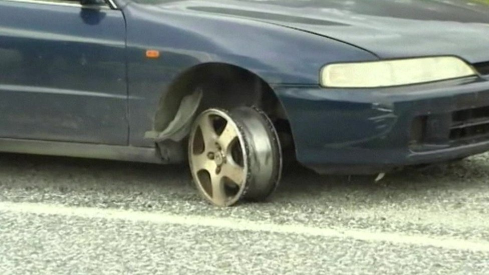 Fugitives car with destroyed tyre