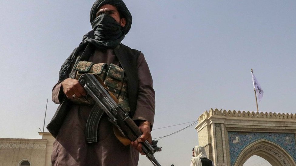 Afghanistan crisis / Taliban resurgence: Armed Taliban (or Taleban) militia fighter stands guard at a checkpoint in Kandahar, Afghanistan, 17th August 2021.