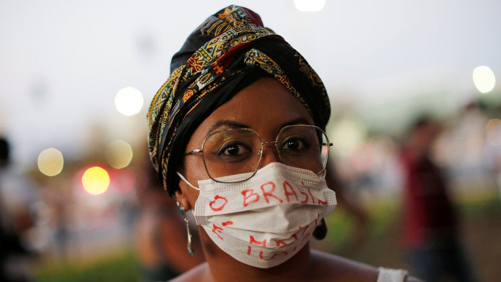 Brazilian woman in a face mask at demonstration - 23 August 2019