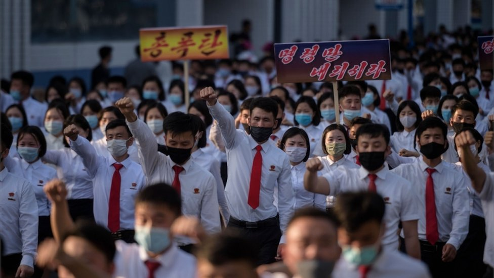 """North Korean students take part in a rally denouncing """"defectors from the North"""" as they march from the Pyongyang Youth Park Open-Air Theatre to Kim Il Sung Square in Pyongyang on June 8, 2020"""