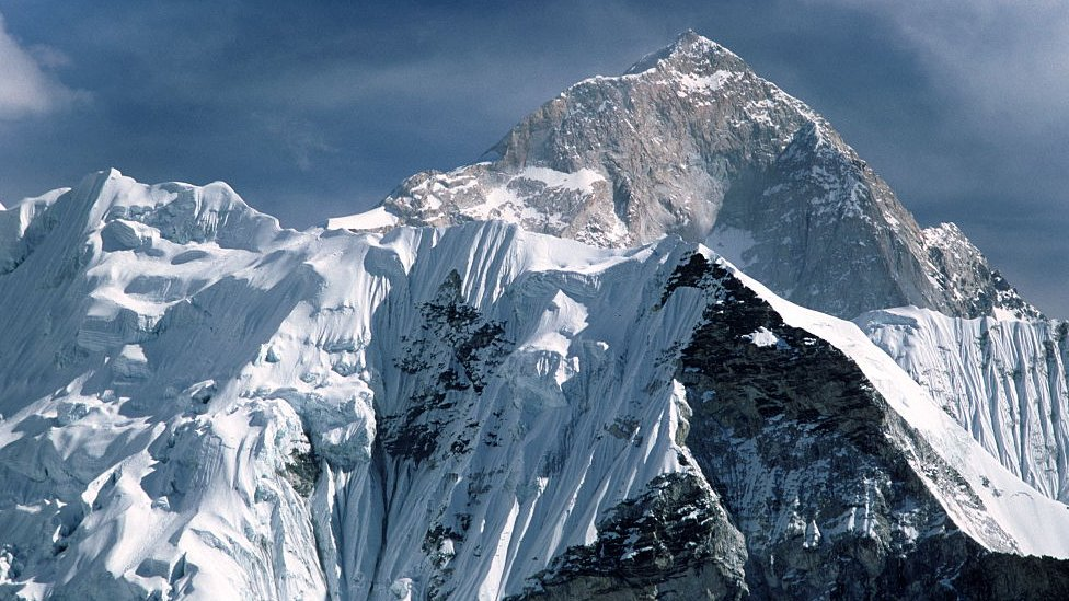 Mt Everest stands behind Mt Nuptse as seen from the Nepal side