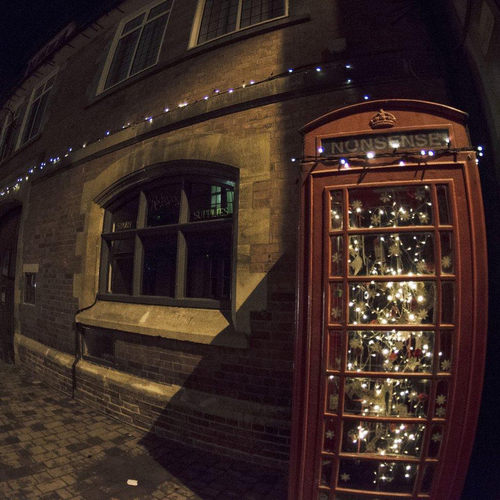 Telephone box full of Christmas lights