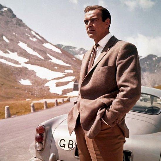 Goldfinger still - Bond with Aston Martin