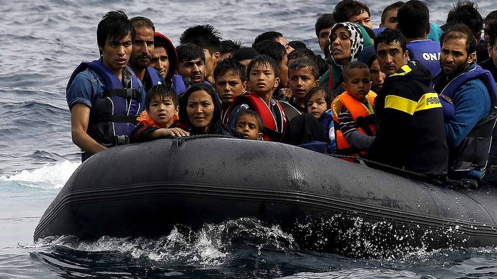 Afghan migrants arrive on the Greek island of Lesbos in an overcrowded dinghy