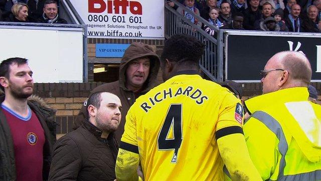 Aston Villa fans argue with captain Micah Richards