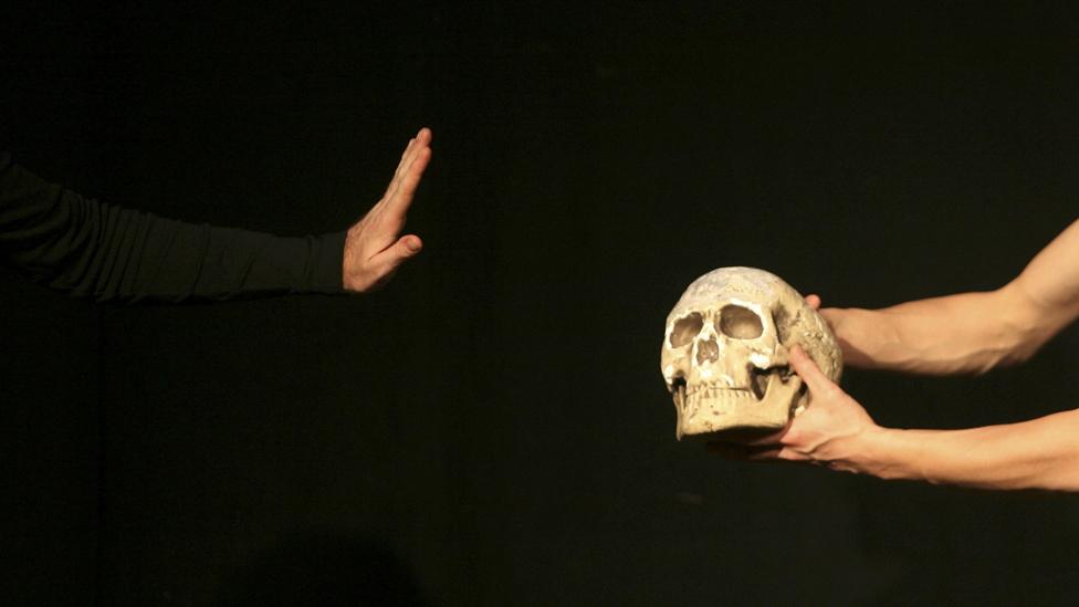 Actor holding skull