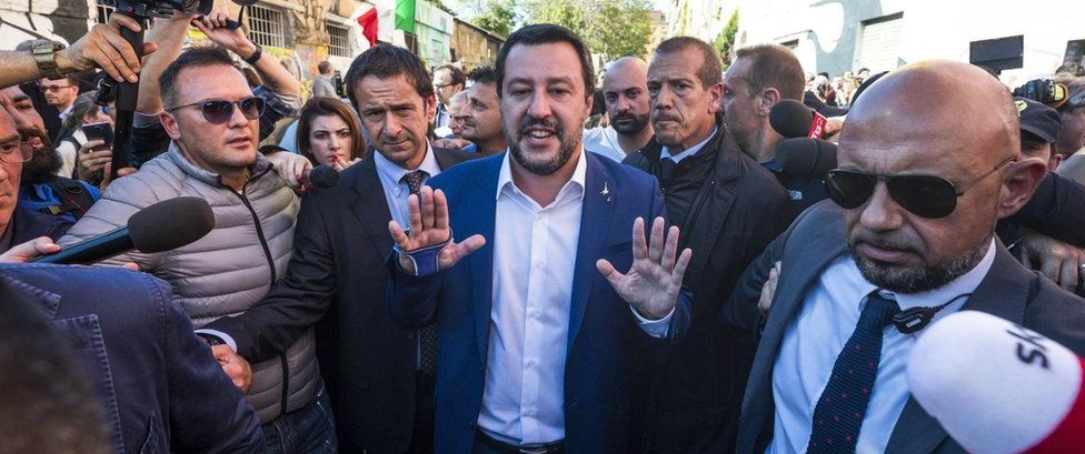 Interior Minister and Deputy Premier Matteo Salvini (C) reacts as he visited the abandoned building in the San Lorenzo district of Rome