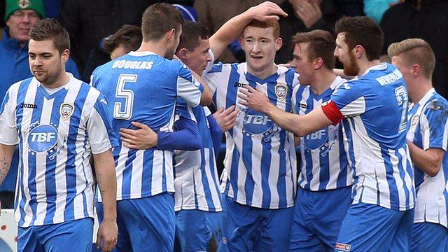 Coleraine players celebrate with goalscorer Rodney Browne