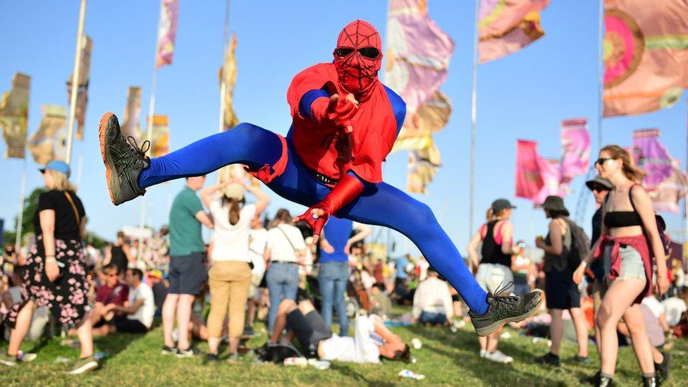 A man dressed as spider-man at Glastonbury
