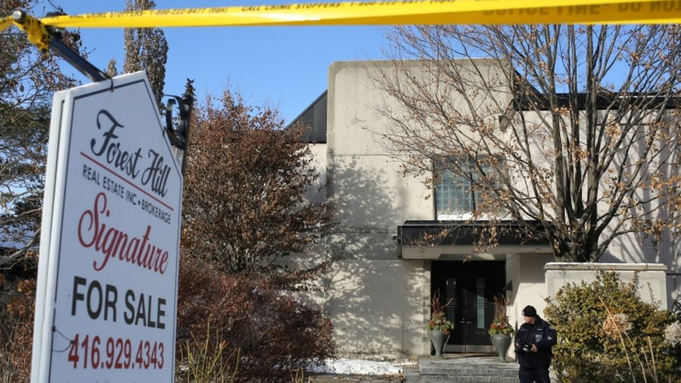 Police work at the home of Barry and Honey Sherman in Toronto
