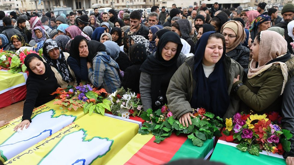 Syrian women mourn at the funeral in Afrin city of several civilians and fighters killed during the Turkish offensive on the Kurdish enclave on Afrin (25 January 2018)