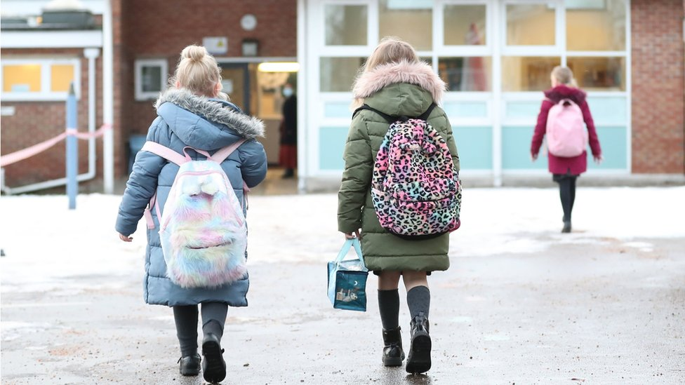 Pupils arriving at a school and nursery in Cheshire
