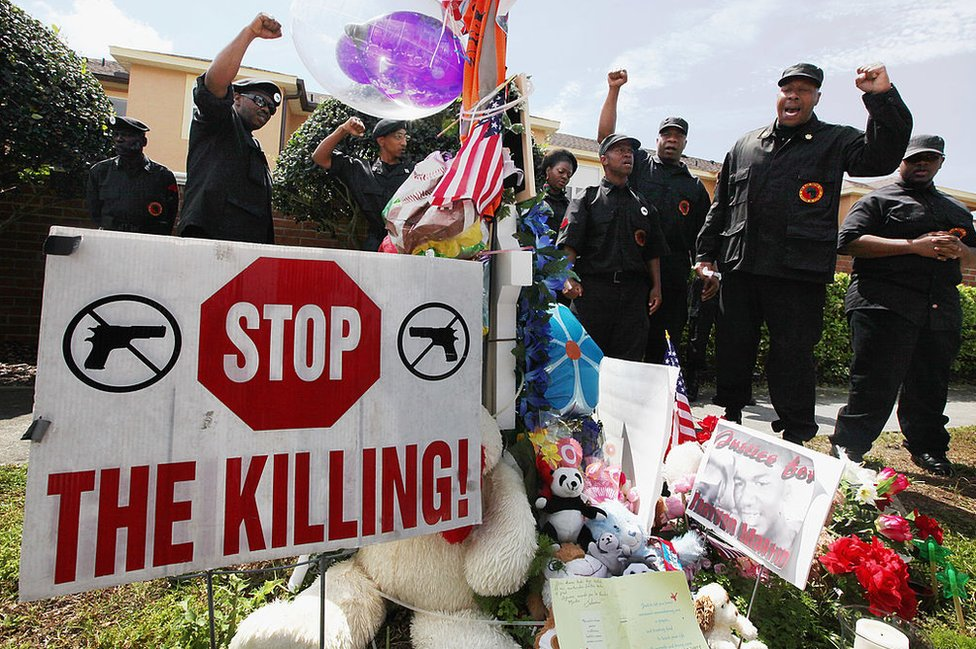 Members of the New Black Panther Party rally at a Florida memorial to Trayvon Martin