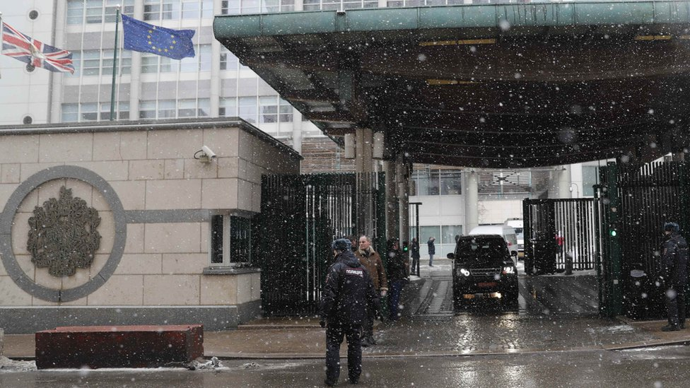 A convoy of vehicles leaves the British Embassy in Moscow